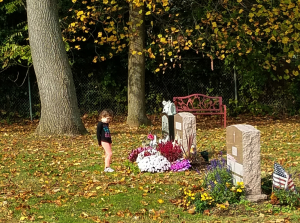 Hailey, now 5, at her mother's grave